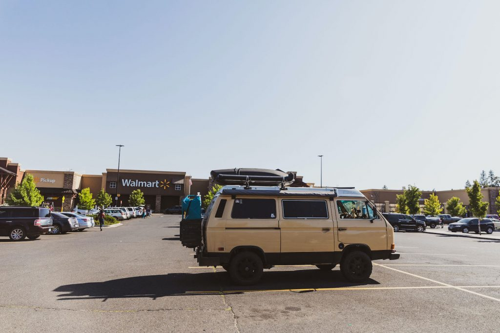 Digital nomads working in their van parked outside of Walmart